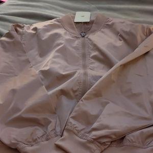 Brand new women's Fabletics xlarge bomber jacket